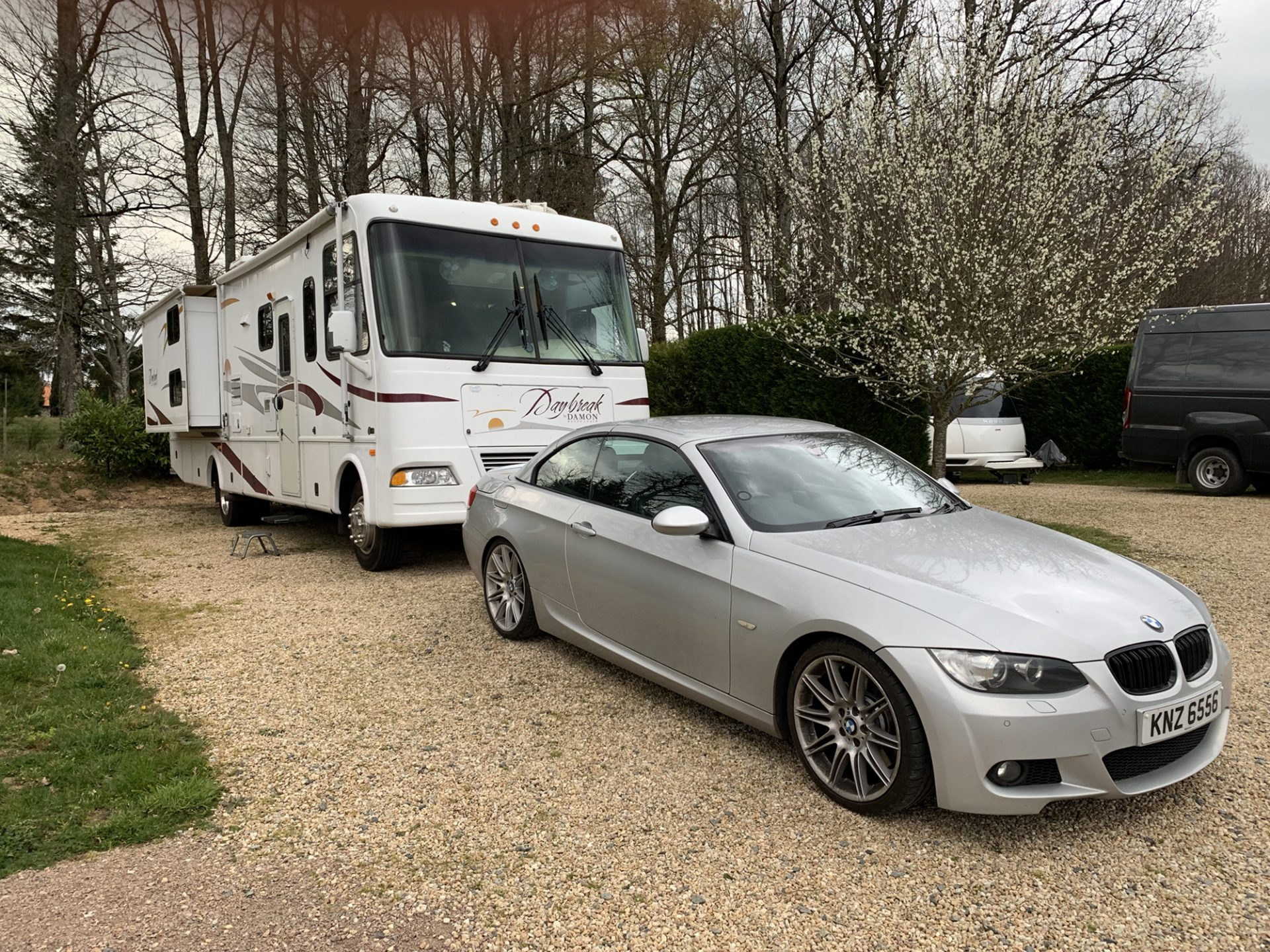 The RV is pitched with the BMW in front of it