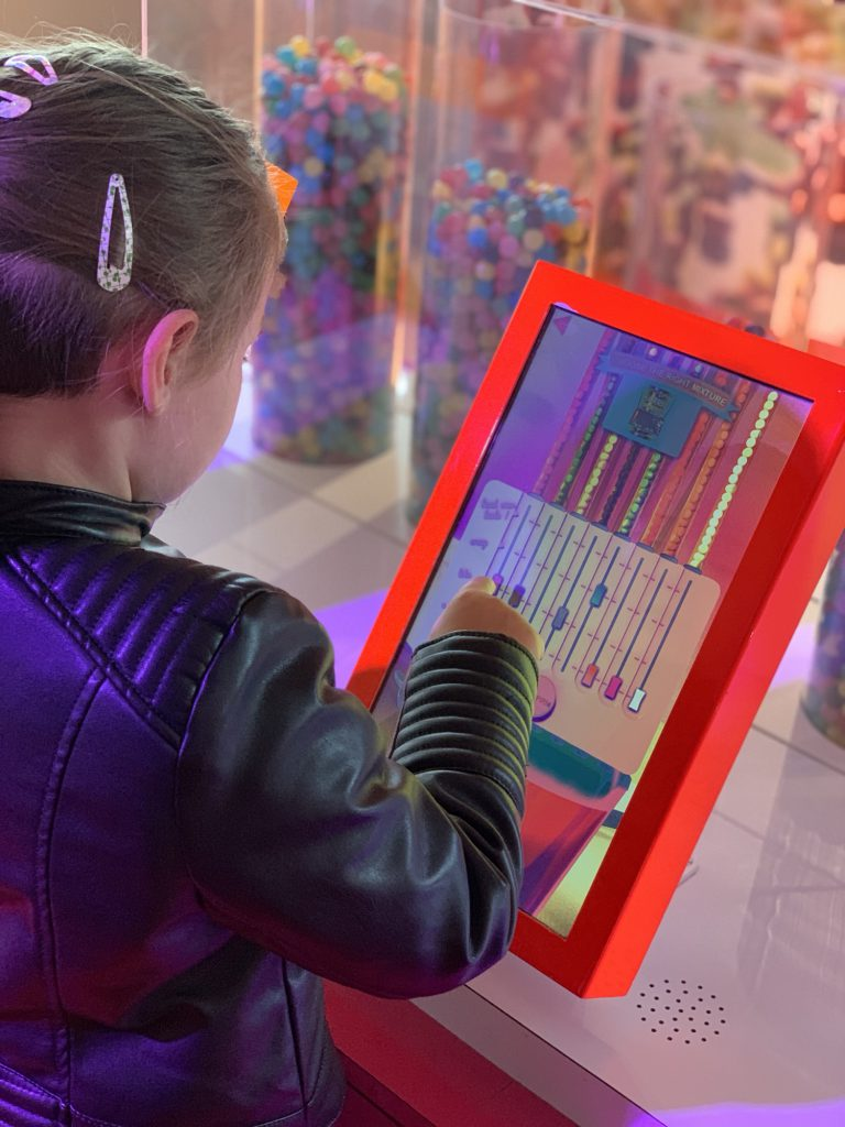 Olivia playing a game at the Haribo Museum
