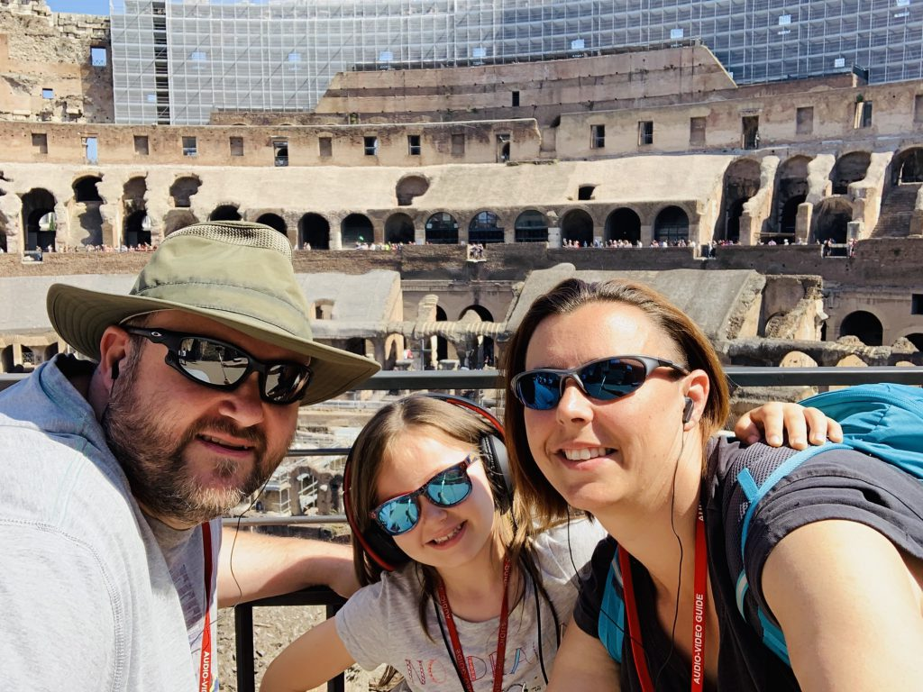 Us inside the Colosseum Rome