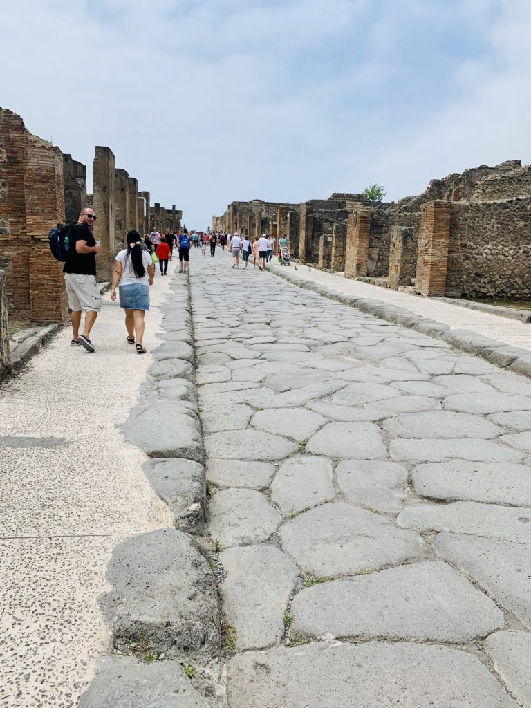 Street of shops with flats above at Pompeii