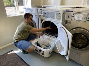 Karen loading a tumble dryer