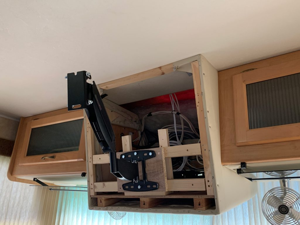 TV mount is extended out from the cabinet