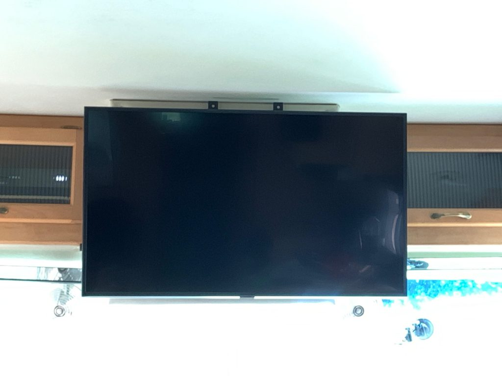 TV hanging from the front cupboards