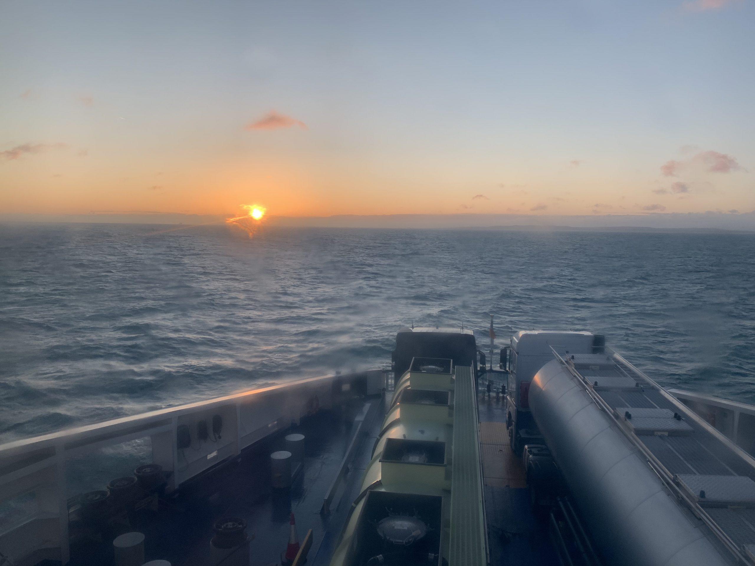 Sun set over sea on Ferry