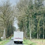 RV Driving through country lane