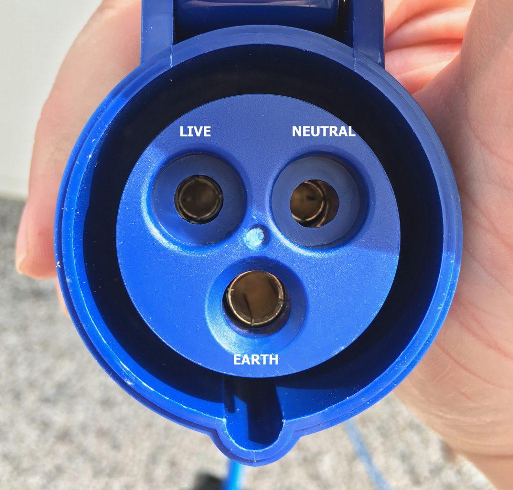 A closeup of a 3 pin caravan socket, showing the normal terminals